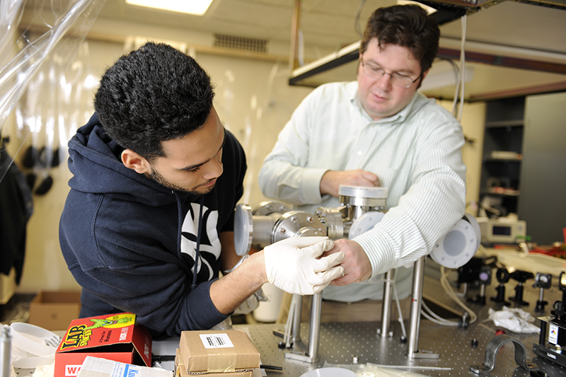 Matthew J. Wright working in the lab with a student